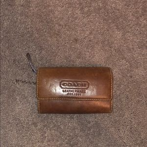 Beautiful brown leather coach wallet with zipper